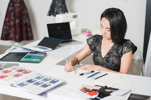 Angela Kim designing custom wedding dresses