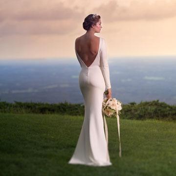 Denika in a custom silk mermaid wedding dress featuring bateaux neck and long sleeves