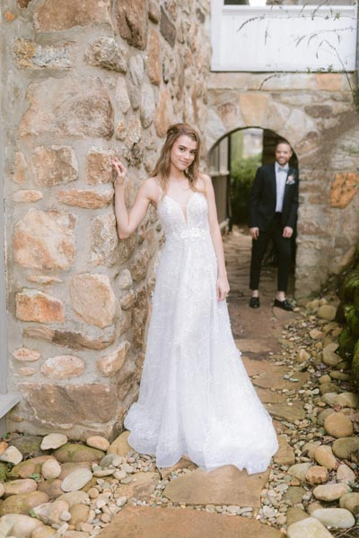 Kyra wearing a custom wedding gown by Angela Kim at the the Greystone Inn