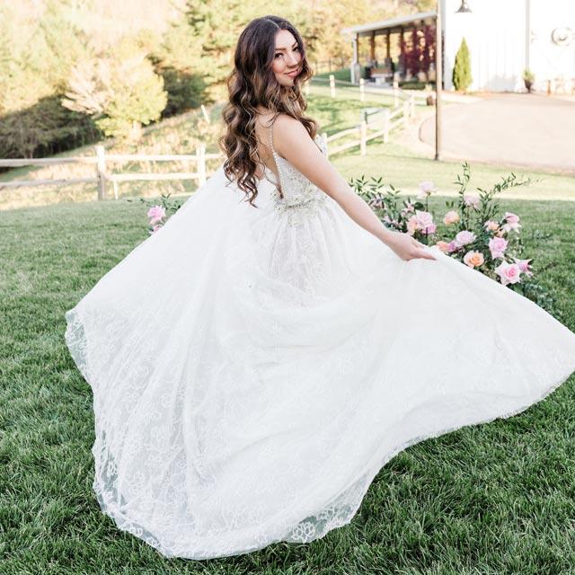Evellina wearing her custom wedding gown