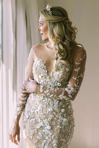 Breigh wearing her custom wedding dress from Angela Kim Couture