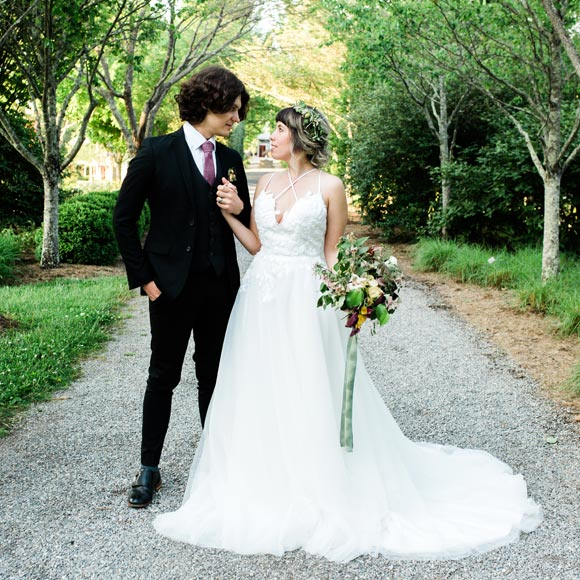 Betsabe wearing her custom wedding dress from Angela Kim Couture