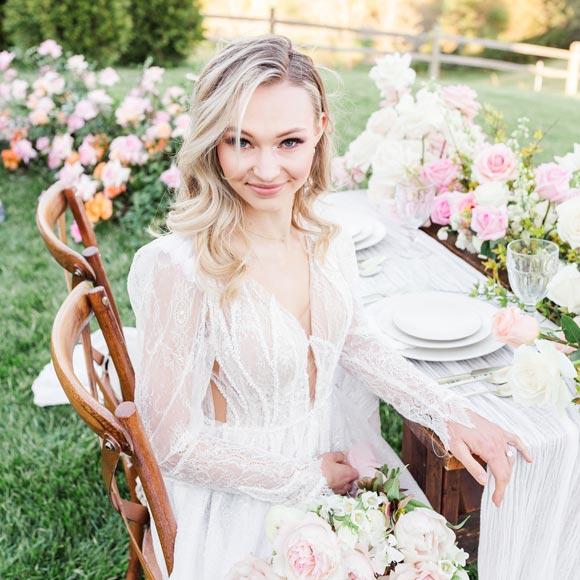 Natalie wearing her custom wedding dress from Angela Kim Couture