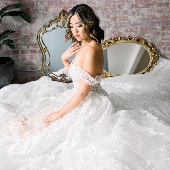 Hannah wearing her custom wedding dress from Angela Kim Couture