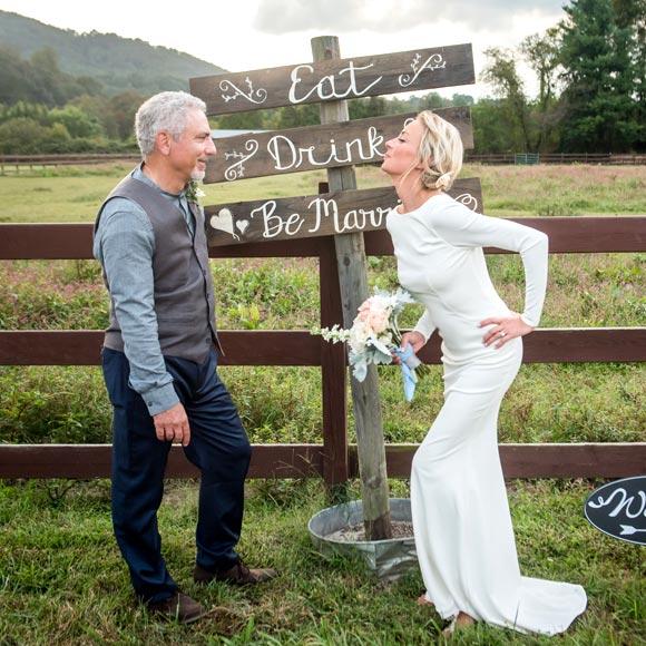 Heidi posing in her custom wedding dress from Angela Kim Couture