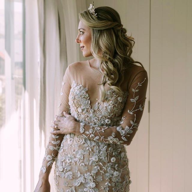 Breigh wearing her handmade custom wedding dress with 3D flowers and handbeading