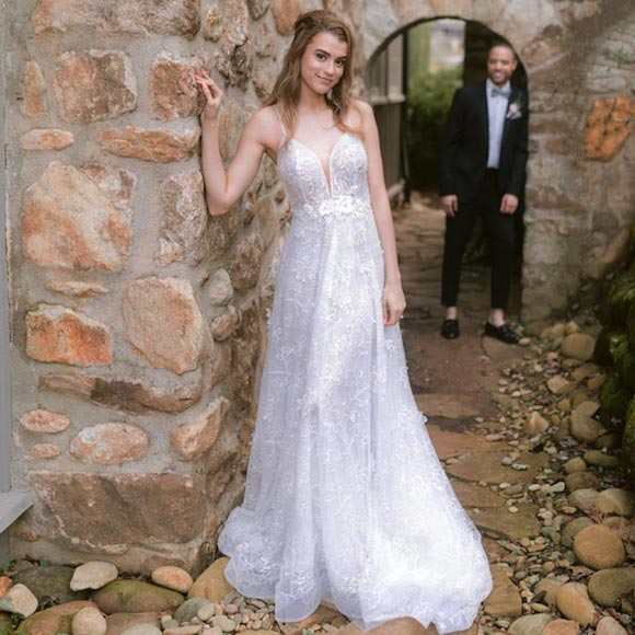 Kyra wearing her custom bridal gown from Angela Kim Couture